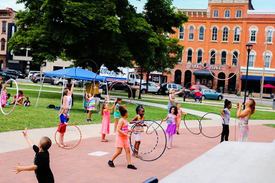 Kids in park practicing hoop