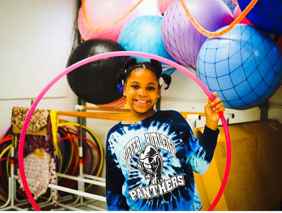 girl holding pink hoop